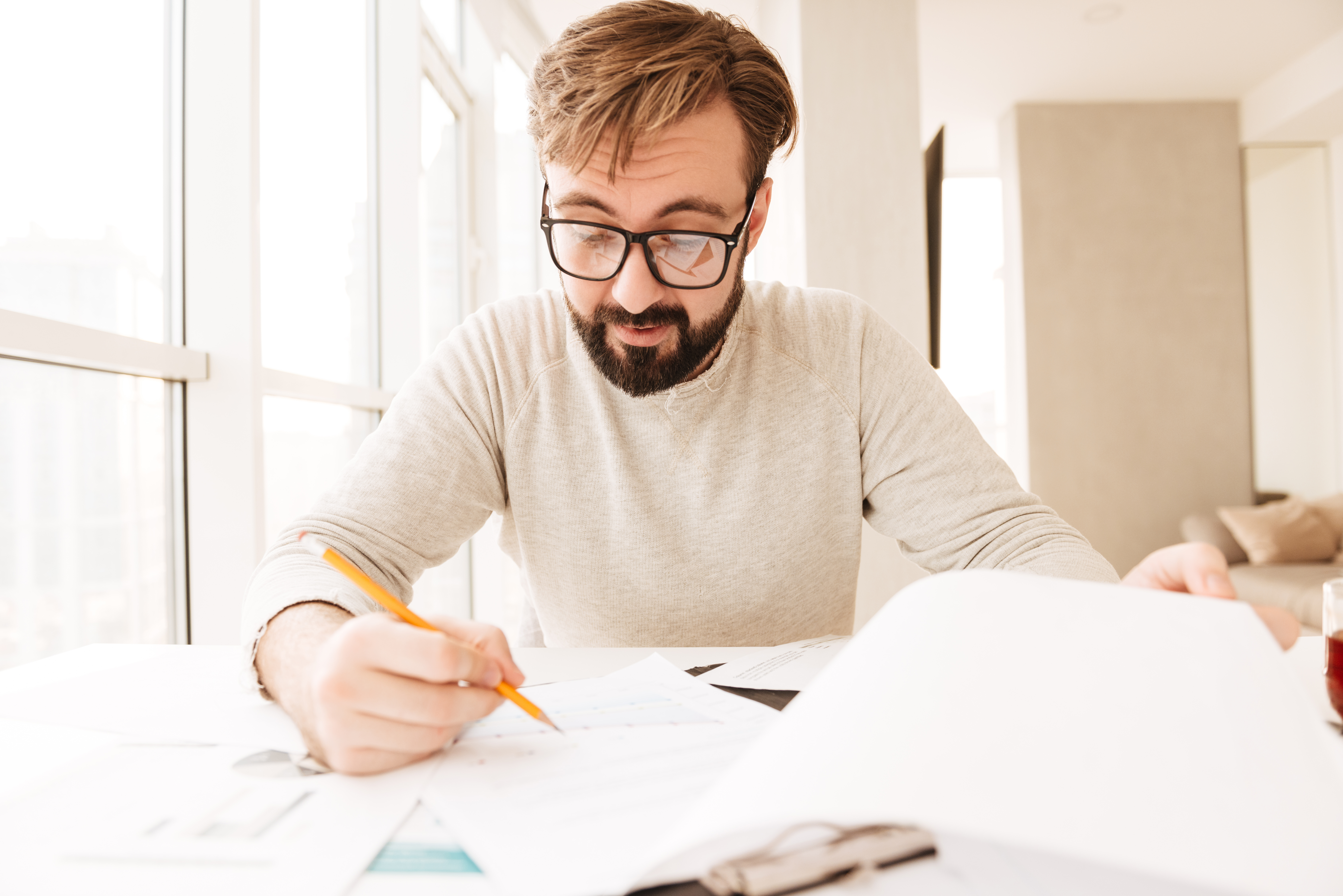portrait-of-a-busy-man-working-with-documents-P8D3UTC